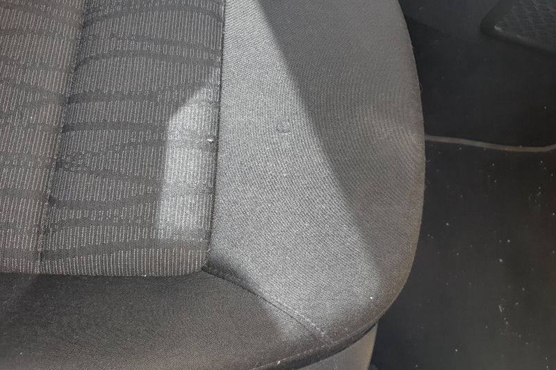 Photo gallery, detail of repaired burnt fabric seats from cigarettes